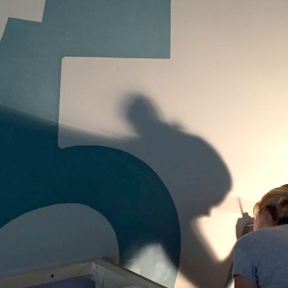 Working in the spotlight, painting the wall logo of BIJ57